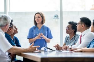 Nurse talking to colleagues