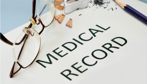 MDM medical record with glasses.
