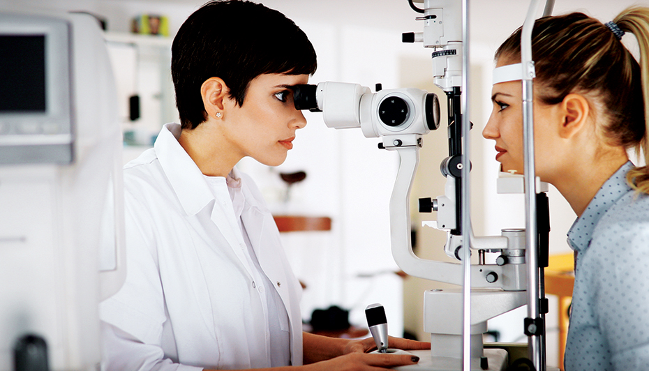 Optometrist performing eye exam.