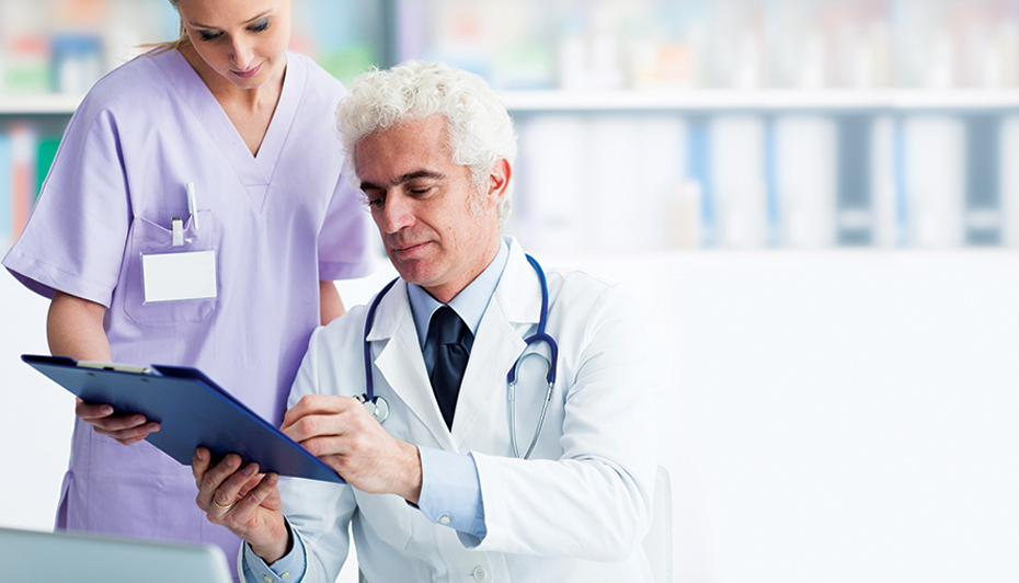 Doctor and nurse reviewing chart