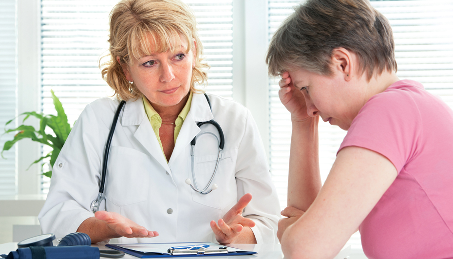 Doctor talking to distressed patient