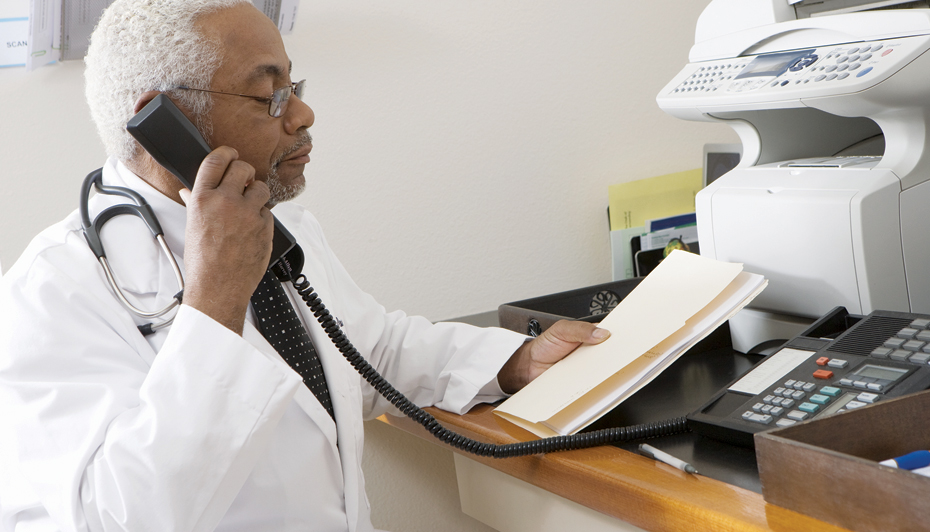 Male doctor talking on the phone