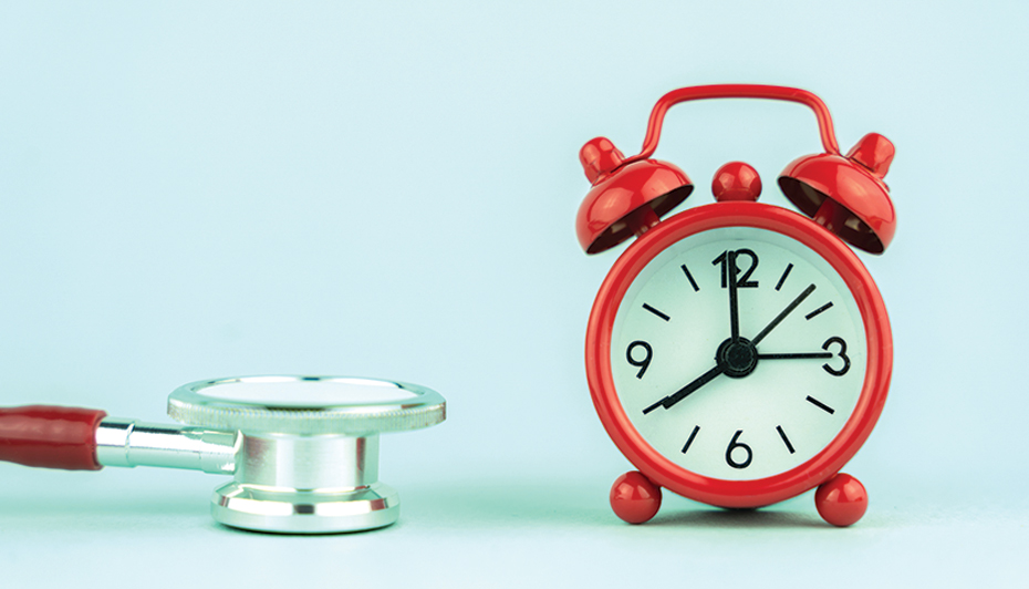 stethoscope and alarm clock