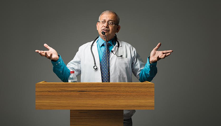 Male medical speaker at podium